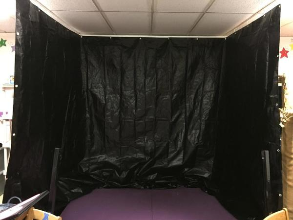 Black Tarp Hung from Ceiling