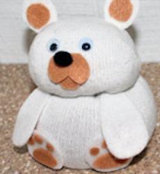 a sample teddy bear made from a sock