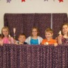 The cast: K-2 graders act out the story